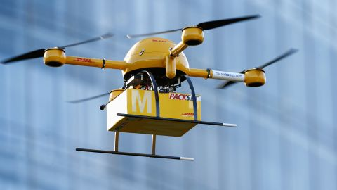 """A drone delivers medicine from a nearby pharmacy to the Deutsche Post headquarters in Bonn, Germany, on December 9, 2013. The company was testing the viability of using drones to deliver small packages over short distances. Online retailer Amazon has also <a href=""""http://www.cnn.com/2013/12/02/tech/innovation/amazon-drones-questions/index.html"""">announced plans</a> to start using unmanned flying vehicles."""
