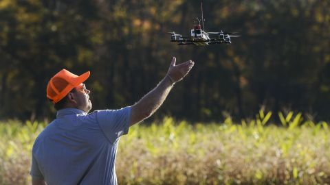 A drone designed to capture footage of illegal hunting activities lands after taking footage at Erwin Wilder Wildlife Management Area in Norton, Massachusetts, on October 21, 2013.