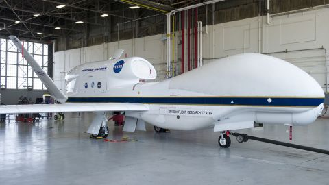A NASA Global Hawk drone sits in an airplane hangar during a Hurricane and Severe Storm Sentinel, or HS3, mission at NASA's Wallops Flight Facility in Wallops Island, Virginia, on September 10, 2013. The HS3 mission uses two of the unmanned aircraft to fly over tropical storms and hurricanes to monitor weather conditions.