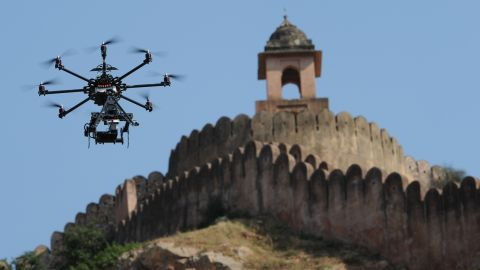 """A drone fitted with a film camera shoots aerial footage during the production of the film """"The Girl with the Indian Emerald"""" in Jaipur, India, on November 7, 2012. While it's already being done in other countries, the U.S. government is considering <a href=""""http://www.cnn.com/2014/06/04/tech/innovation/movies-drones-faa/index.html"""">a request from movie and TV producers</a> to let them use unmanned aircraft to shoot aerial video."""