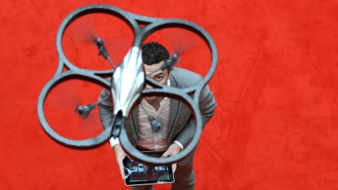 NUREMBERG, GERMANY - FEBRUARY 02:  A  man controls an AR. Drone made by parrot with an Ipad during the press preview day of the International Toy Fair Nuernberg on February 2, 2011 in Nuremberg, Germany.   2,683 exhibitors will present their new toy products until February 8, 2011.  (Photo by Miguel Villagran/Getty Images)