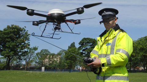 Derek Charlton of the Merseyside Police operates the department's new aerial surveillance drone in Liverpool, England, on May 21, 2007.