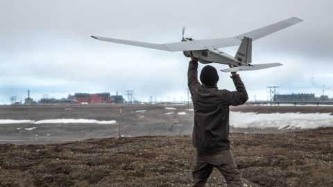 """An AeroVironment Puma drone undergoes pre-flight tests in Prudhoe Bay, Alaska, on June 7, 2014. The drone will be used to survey roads, pipelines and other equipment at the largest oil field in the United States. The Federal Aviation Administration authorized BP to conduct the <a href=""""http://www.cnn.com/2014/06/10/us/faa-commercial-drone-approval/index.html"""">first-ever commercial drone flights</a> over land."""