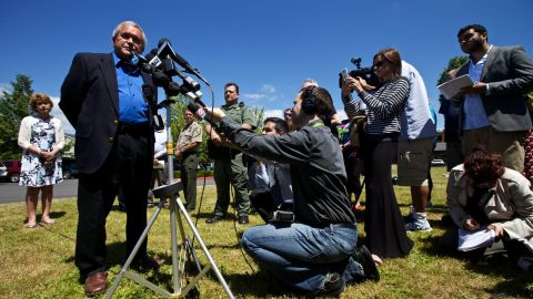 Troutdale Mayor Doug Daoust addresses reporters at a June 10 press conference in a Safeway parking lot near the school.