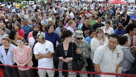 Parents anxiously wait for their children at the shopping center parking lot in Wood Village on June 10.