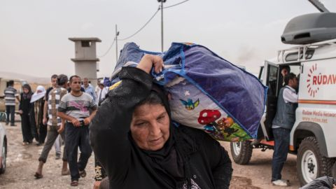 The rush from Mosul led to bottlenecks at checkpoints as people tried to reach safety in Erbil, about 90 kilometers (56 miles) to the east.