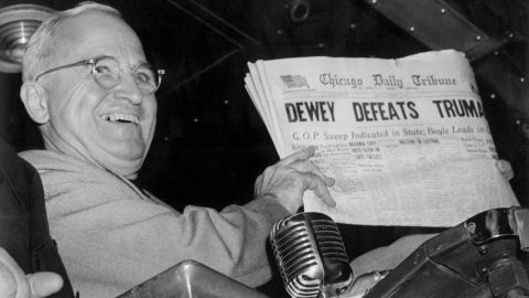 """1948: Democratic U.S. President Harry Truman defeated challenger NY Republican Gov. Thomas Dewey. In this Nov. 4, 1948, file photo, President Harry S. Truman holds up an election day edition of the Chicago Daily Tribune, which, based on early results, mistakenly announced """"Dewey Defeats Truman."""""""