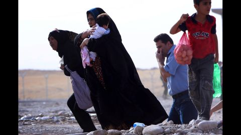 Families gather at a checkpoint in Iraq's Kurdish region on June 11.