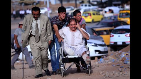 A man in a wheelchair is among those fleeing the violence on June 11.