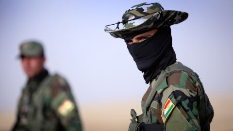 A security guard is seen at a Kurdish checkpoint on June 11.