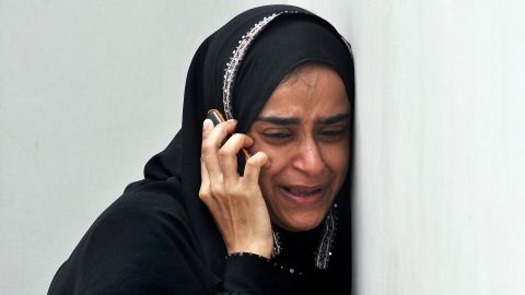A Pakistan woman mourns at the morgue, the death of a relative who was found inside the premises of a cold-storage cargo facility at the Jinnah International Airport in Karachi on June 10, 2014, following the early June 9 attack by militants on the airport. The second attack on Pakistan's Karachi airport in as many days ended without casualties, officials said, but with the escape of the two gunmen involved.