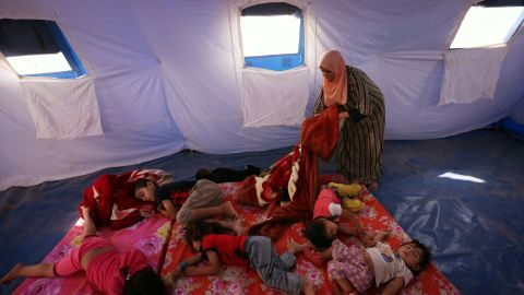 Young refugees sleep in a tent at a temporary camp in Aski Kalak, Iraq, on June 12.