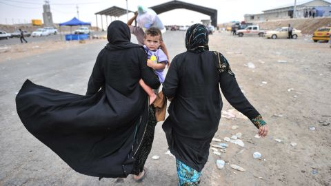 Civilians escape from Mosul to a camp managed by United Nations and the  Kurd government near Erbil, Iraq on Thursday, June 12.