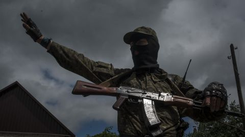 A pro-Russian fighter stands guard at a checkpoint in Slovyansk on June 12.