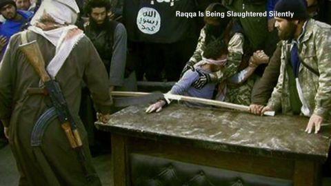 pkg mann iraq syria life under isis_00020102.jpg