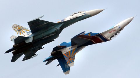 """A Russian Air Force flight demonstration team performs with their Su-27 jet fighters over St. Petersburg, Russia. An Su-27 """"showed its belly"""" to a U.S. reconnaissance jet in April 2014."""