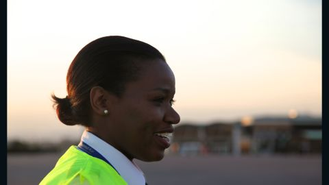 """As Rwanda's first female commercial pilot, Esther Mbabazi wants women to realize they can do anything. """"Time has changed. Women are out there working, technology has changed, and everyone has the brains to do something, now it's not about how much bicep or how much energy you have."""""""