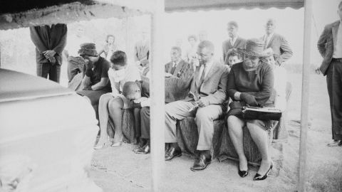 Ben Chaney, slumped over, weeps at the August 7, 1964, funeral of his brother, James Earl Chaney.