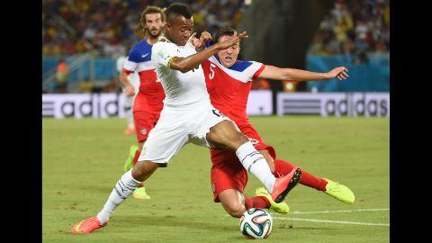 Ghana's forward Jordan Ayew vies with U.S. defender Matt Besler.