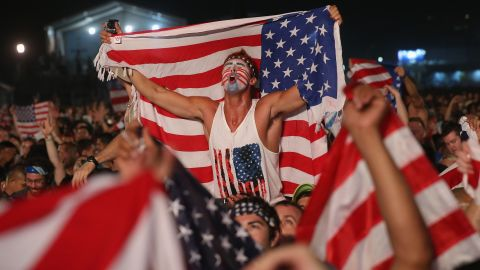 American fans celebrate on Copacabana beach in Rio after the United States beat Ghana 2-1.