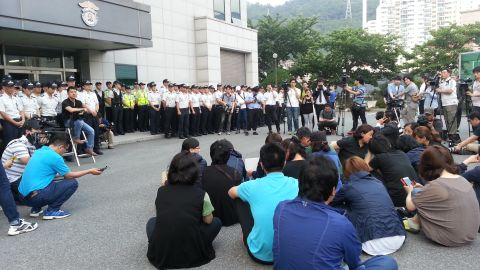 Relatives of the passengers on the Sewol ferry wait outside the Gwangju District Prosecutor's office on June 10, 2014.