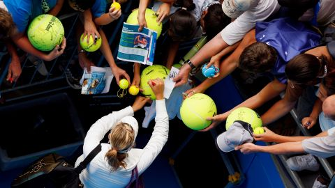 Fans scramble for an autograph from Sharapova at the 2008 Australian Open where she won in the final against Ana Ivanovic, having not dropped a set all tournament.