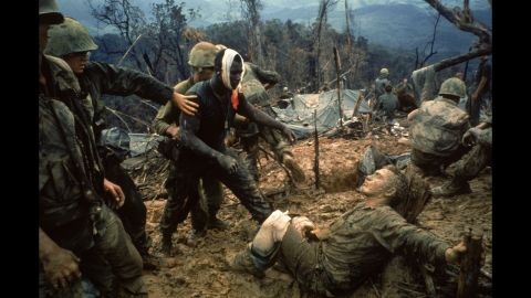 """1960s photojournalists showed the world some of the most dramatic moments of the Vietnam War through their camera lenses. LIFE magazine's Larry Burrows photographed wounded Marine Gunnery Sgt. Jeremiah Purdie, center, reaching toward a stricken soldier after a firefight south of the Demilitarized Zone in Vietnam in 1966. Commonly known as <a href=""""http://life.time.com/history/vietnam-war-the-story-behind-larry-burrows-1966-photo-reaching-out/#1"""" target=""""_blank"""" target=""""_blank"""">Reaching Out,</a><em> </em>Burrows shows us tenderness and terror all in one frame. According to LIFE, the magazine did not publish the picture until five years later to commemorate Burrows, who was killed with AP photographer Henri Huet and three other photographers in Laos."""