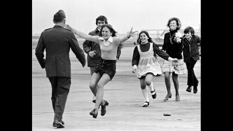 """Newly freed U.S. prisoner of war  Air Force Lt. Col. Robert L. Stirm is greeted by his family at Travis Air Force Base in Fairfield, California, in 1973. This Pulitzer Prize-winning photograph, named Burst of Joy, was taken by Associated Press photographer Sal Veder. """"You could feel the energy and the raw emotion in the air,""""<a href=""""http://www.smithsonianmag.com/history/coming-home-106013338/?no-ist="""" target=""""_blank"""" target=""""_blank""""> Veder told Smithsonian Magazine in 2005. </a>"""