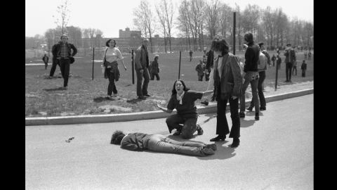 Mary Ann Vecchio screams as she kneels over Jeffrey Miller's body during the deadly anti-war demonstration at Kent State University in 1970. Student photographer John Filo captured the Pulitzer Prize-winning image after Ohio National Guardsmen fired into a crowd of protesters, killing four students and wounding nine others. An editor manipulated a version of the image to remove the fence post above Vecchio's head, sparking controversy.