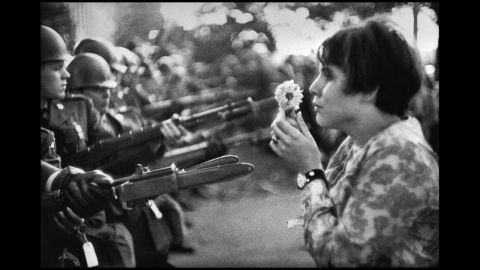"""Frenchman Marc Riboud captured one of the most well-known anti-war images in 1967. Jan Rose Kasmir confronts National Guard troops outside the Pentagon during a protest march. The photo helped turn public opinion against the war. """"She was just talking, trying to catch the eye of the soldiers, maybe try to have a dialogue with them,"""" <a href=""""http://www.smithsonianmag.com/history/flower-child-102514360/"""" target=""""_blank"""" target=""""_blank"""">recalled Riboud in the April 2004 Smithsonian magazine,</a> """"I had the feeling the soldiers were more afraid of her than she was of the bayonets."""""""