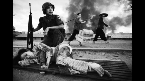 """Legendary Welsh war photographer Philip Jones Griffiths captured the battle for Saigon in 1968. U.S. policy in Vietnam was based on the premise that peasants driven into the towns and cities by the carpet-bombing of the countryside would be safe. Furthermore, removed from their traditional value system, they could be prepared for imposition of consumerism. This """"restructuring"""" of society suffered a setback when, in 1968, death rained down on the urban enclaves. In 1971 Griffiths published """"Vietnam Inc."""" and it became one of the most sought after photography books."""