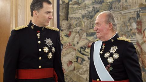 King Felipe VI of Spain, left, took up his father King Juan Carlos' title on June 19. Above, the father and son are attend a ceremony on the day of the new king's coronation.