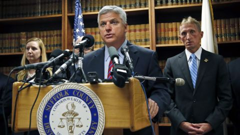 At a news conference in May 2014, Suffolk County District Attorney Dan Conley announces that Hernandez has been indicted for the July 2012 killings of Daniel de Abreu and Safiro Furtado.