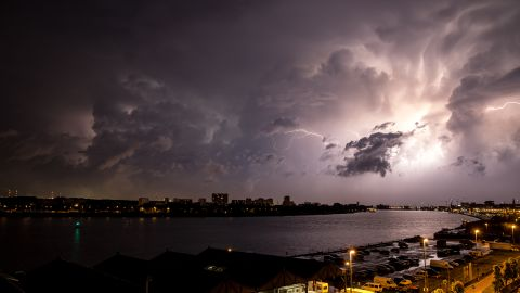 """In Antwerp, Belgium, <a href=""""http://ireport.cnn.com/docs/DOC-1145336"""">Zachary Koulermos</a> was woken up by a hailstorm in June. After the hail subsided, the rain brought an """"amazing lightning storm,"""" he said. He grabbed his camera and tripod as the clouds retreated."""
