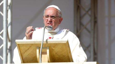 Pope Francis holds his omelia as he attends a mass during the feast-day Mass of Corpus Domini on the plains of the small town of Sibari on June 21, 2014 in Sibari Cosenza, Italy. Pope Francis concluded his one-day trip to the southern Italian region of Calabria with strong words against the Calabrian mafia, calling it 'adoration of evil and contempt for the common good, mafiosi are excommunicated, not in communion with God.'