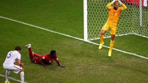 Silvestre Varela of Portugal scores his team's second goal as goalkeeper Tim Howard of the United States looks on during the 2014 FIFA World Cup Brazil Group G match between the United States and Portugal at Arena Amazonia on June 22, 2014 in Manaus, Brazil. (Photo by Elsa/Getty Images