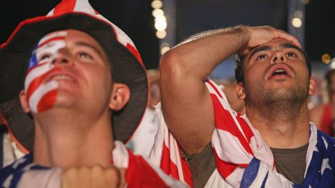 USA soccer fans watch their team play against Portugal on a screen setup at the FIFA Fan Fest on Copacabana beach June 22, 2014 in Rio de Janeiro, Brazil. The match ended in a tie 2-2. (Photo by Joe Raedle/Getty Images)