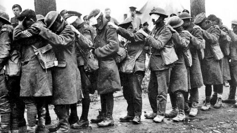"""Men of the British Army's 55th Division, blinded by a poison gas attack, in April 1918. British soldier Wilfred Owen captured the panic of an attack in verse """"Gas! Gas! Quick, boys! -- An ecstasy of fumbling, Fitting the clumsy helmets just in time; But someone still was yelling out and stumbling, And flound'ring like a man on fire or lime."""""""