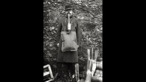 """A soldier demonstrates an ungainly French gas mask. """"French masks were notoriously unreliable,""""<a href=""""http://www.ncbi.nlm.nih.gov/pmc/articles/PMC2376985/"""" target=""""_blank"""" target=""""_blank""""> wrote</a> historian Gerald Fitzgerald."""