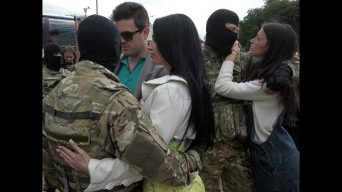 People say goodbye to volunteer soldiers in Kiev, Ukraine, before they leave for the eastern part of the country to join the ranks of a special battalion on Monday, June 23.