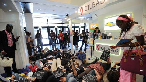 Activists protest drug maker Gilead Sciences to denounce the price of hepatitis C drug Sovaldi in April in Montpellier, France.