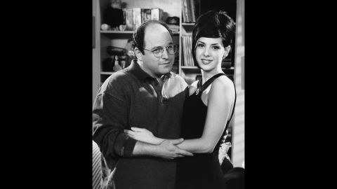 """Marisa Tomei plays herself in season seven's """"The Cadillac."""" George questions his engagement when one of Elaine's friends says she's friends with the Oscar-winning actress and Tomei has a thing for short and quirky bald men. George sets up a date with Tomei and when he reveals he's engaged, she punches him in the eye."""