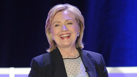 Hillary Clinton was given a pair of running shoes, a reference to her possible run for the presidency in 2016.