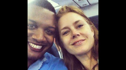 """Journalist Ernest Owens <a href=""""https://twitter.com/MrErnestOwens/status/482588663121858560/photo/1"""" target=""""_blank"""" target=""""_blank"""">tweeted a selfie</a> with actress Amy Adams on Friday, June 27. """"Told @InsideEdition why Amy Adams was classy for giving up her 1st class seat to the soldier sitting next to me!"""" he wrote."""