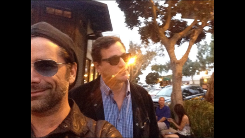 """Comedian Bob Saget, right, <a href=""""http://instagram.com/p/p0ATnXTP2P/"""" target=""""_blank"""" target=""""_blank"""">posted a selfie</a> with his former """"Full House"""" co-star John Stamos on Saturday, June 28. """"Sunset Stamos selfie,"""" he wrote on Instagram."""