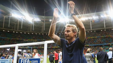 SALVADOR, BRAZIL - JULY 01: Head coach Jurgen Klinsmann of the United States applauds the fans after losing the 2014 FIFA World Cup Brazil Round of 16 match between Belgium and USA at Arena Fonte Nova on July 1, 2014 in Salvador, Brazil. (Photo by Alex Livesey/FIFA/Getty Images)