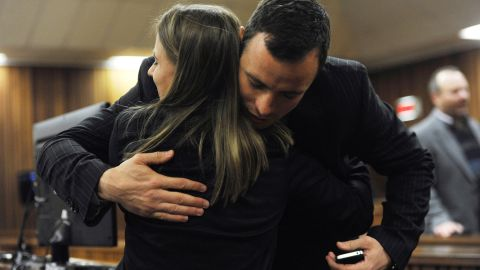 Pistorius hugs a supporter Wednesday, July 2.