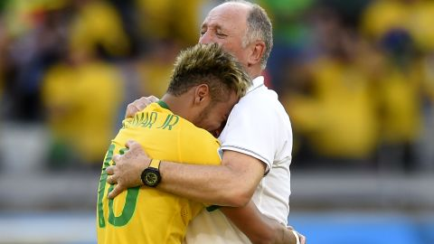 Brazil coach Luiz Felipe Scolari hugs Neymar after the team qualify for the quarter finals after that nervous penalty shoot out win over Chile.