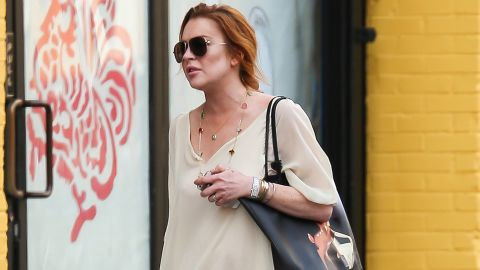 Lindsay Lohan takes a pre-birthday stroll in New York on Tuesday. The actress turned 28 on Wednesday, the day she filed suit.