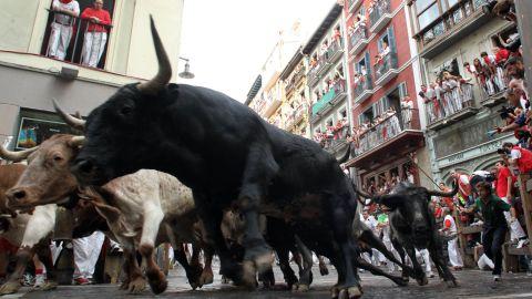 Bulls run around La Curva in Pamplona on July 11, 2010.